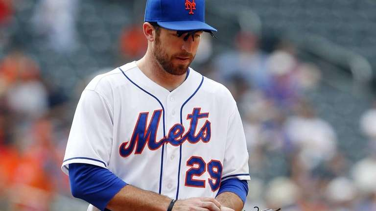 Ike Davis of the Mets stands at first