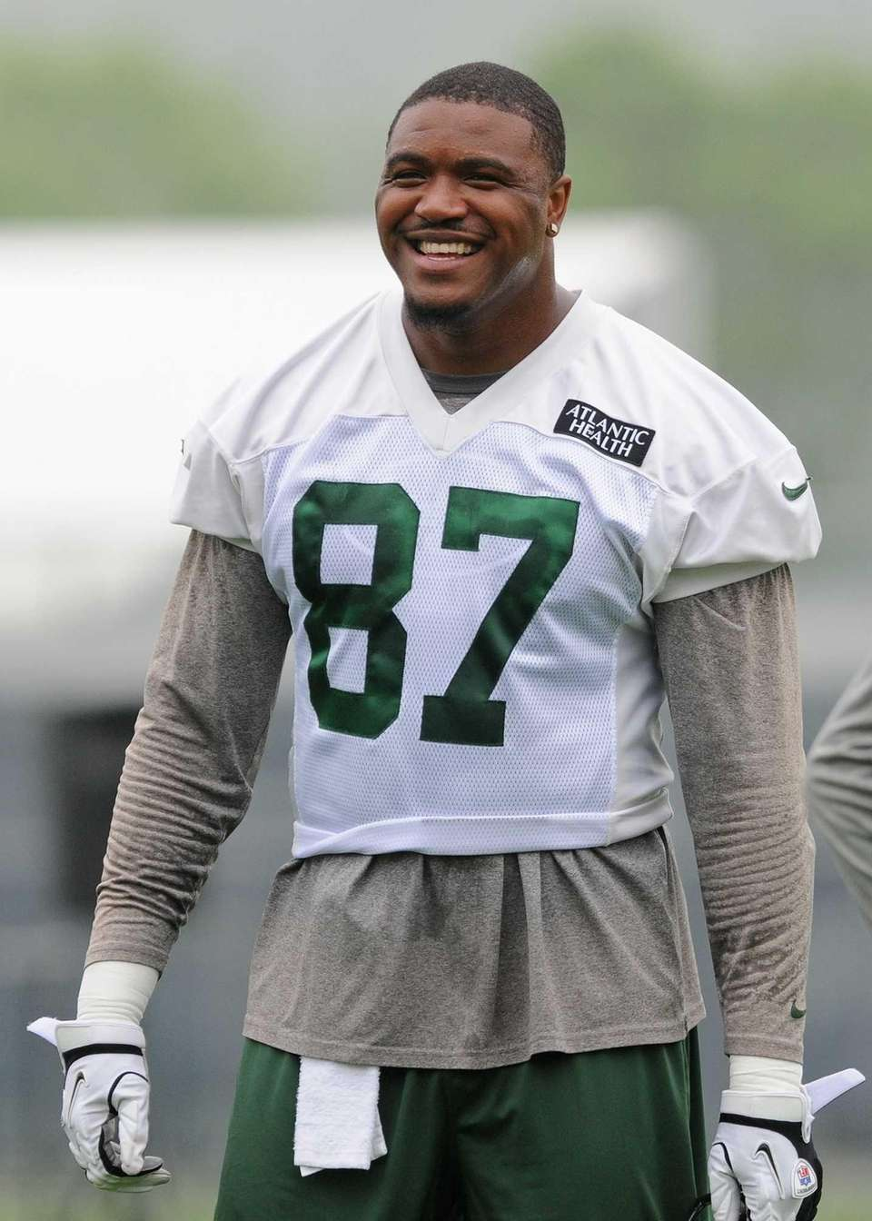 Jeff Cumberland laughs during a break in OTAs