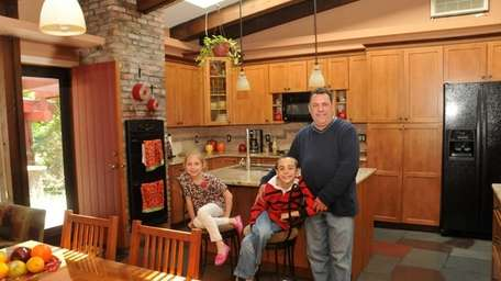 John Cipriano, with daughter Julia, 7, and son