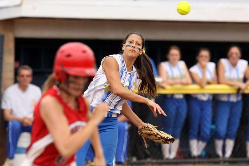 Kellenberg's Sabrina DeAngelis throws to first for an