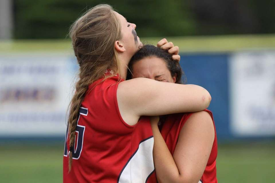 St. John the Baptist's Erin McClafferty, left, and