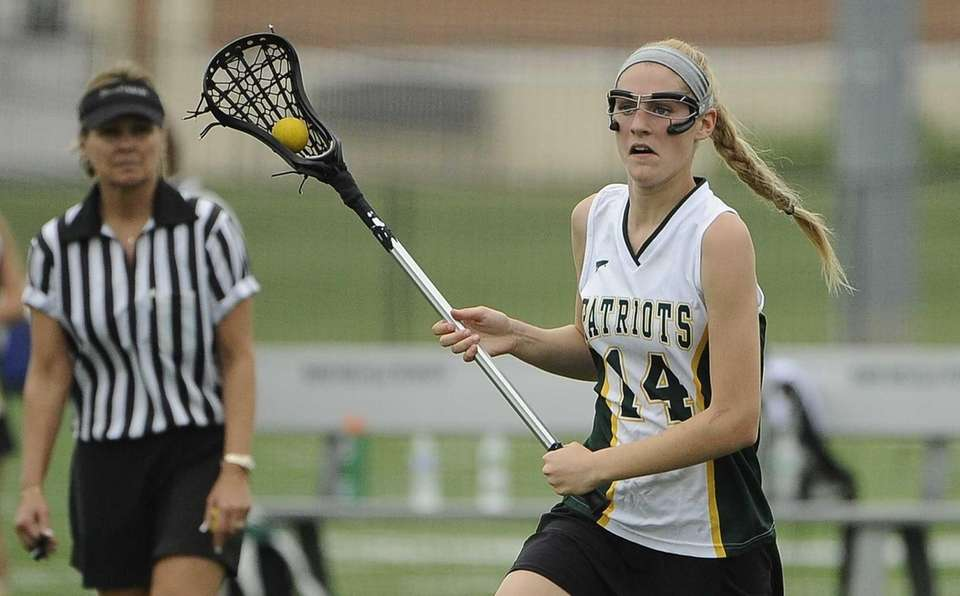 Ward Melville midfielder Ally Tilly controls the ball