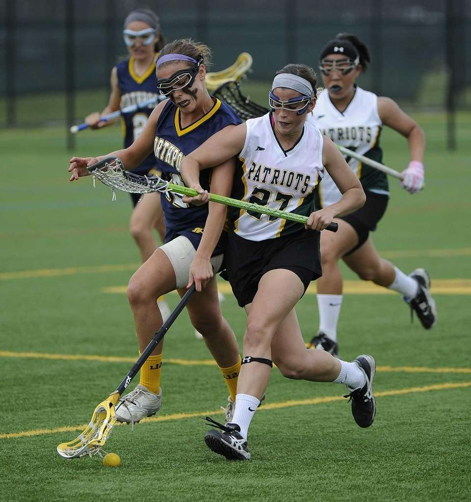 Ward Melville's Samantha Scarfogliero battles for a ground