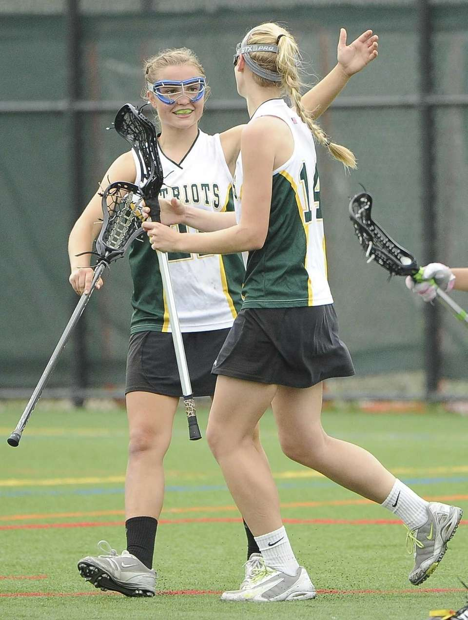 Ward Melville's Maddy Wollmuth, left, celebrates a goal