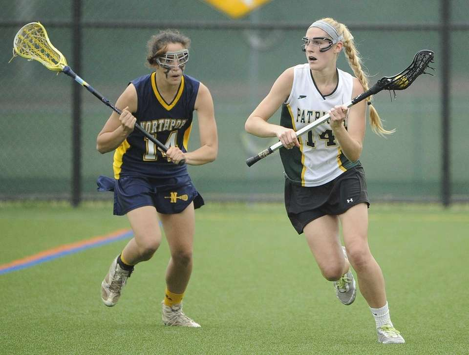 Ward Melville midfielder Ally Tilly is defended by