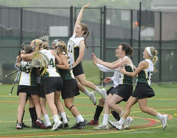 Ward Melville teammates celebrate their 15-14 win against
