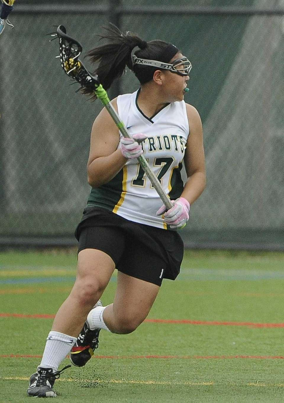 Ward Melville attacker Yuna Hur controls the ball