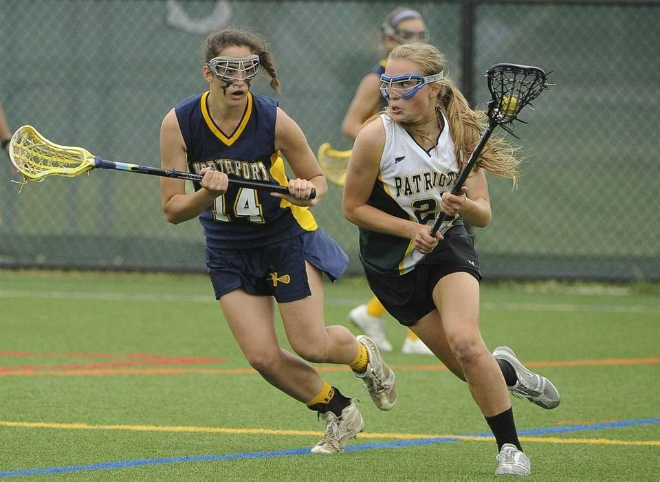 Ward Melville midfielder Maddy Wollmuth is defended by