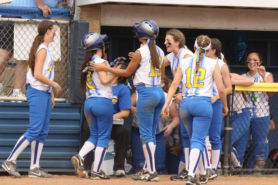 Kellenberg celebrates a seventh-inning run against St. John