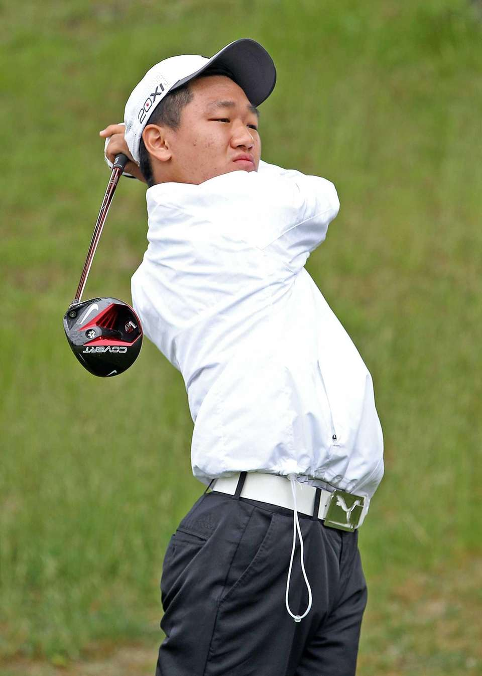 Sewanhaka's Chris Yeom follows through on a drive