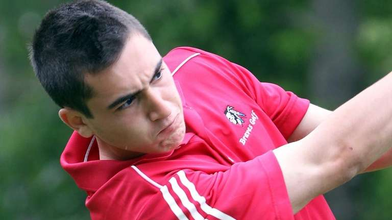 Syosset's James Schlesinger drives the ball at the
