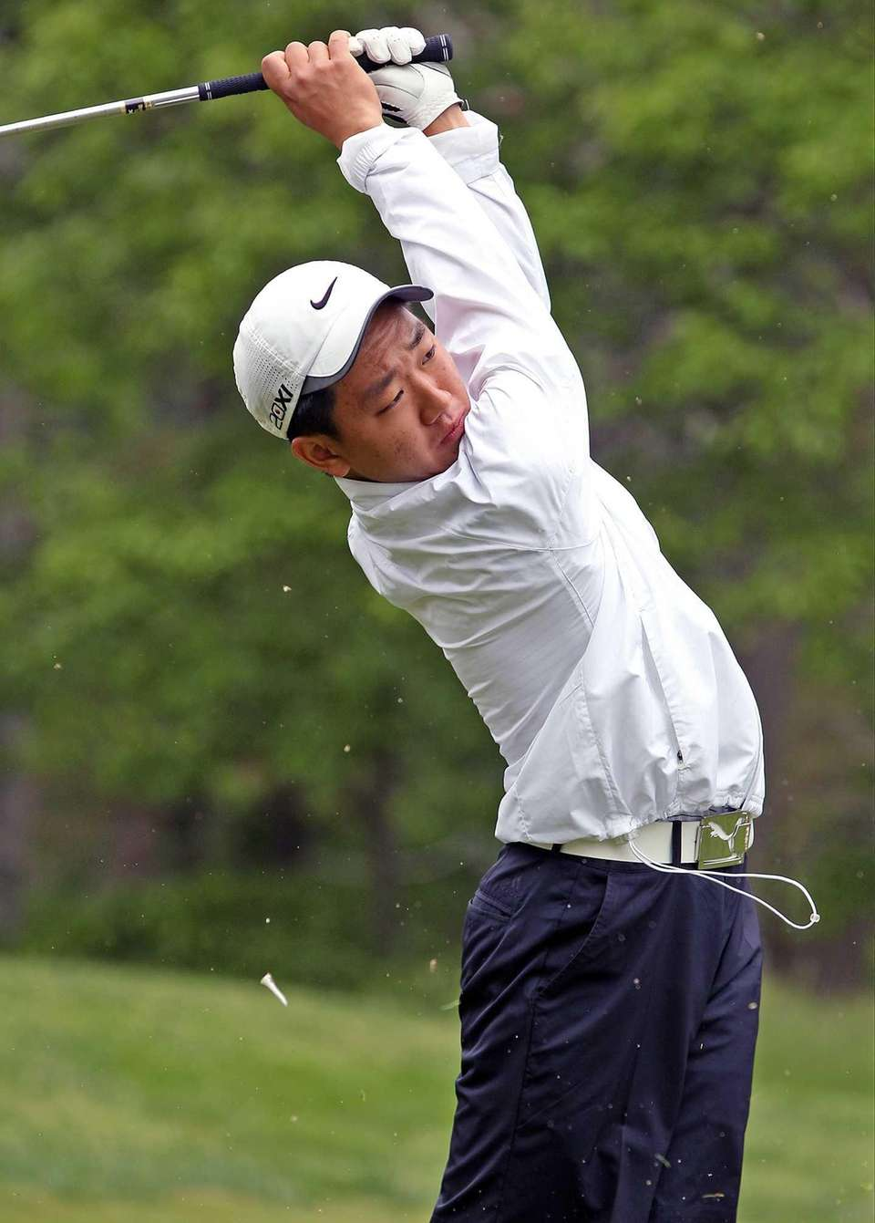 Sewanhaka's Chris Yeom tees off on a hole