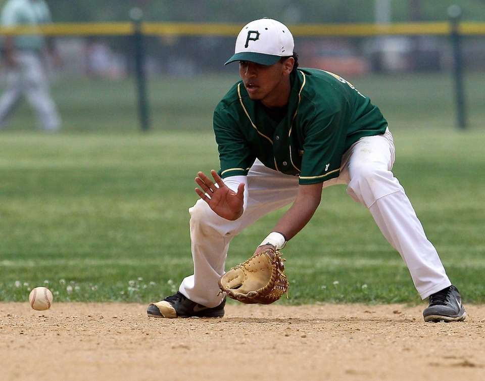 Ward Melville shortstop Chris Cepeda makes the play
