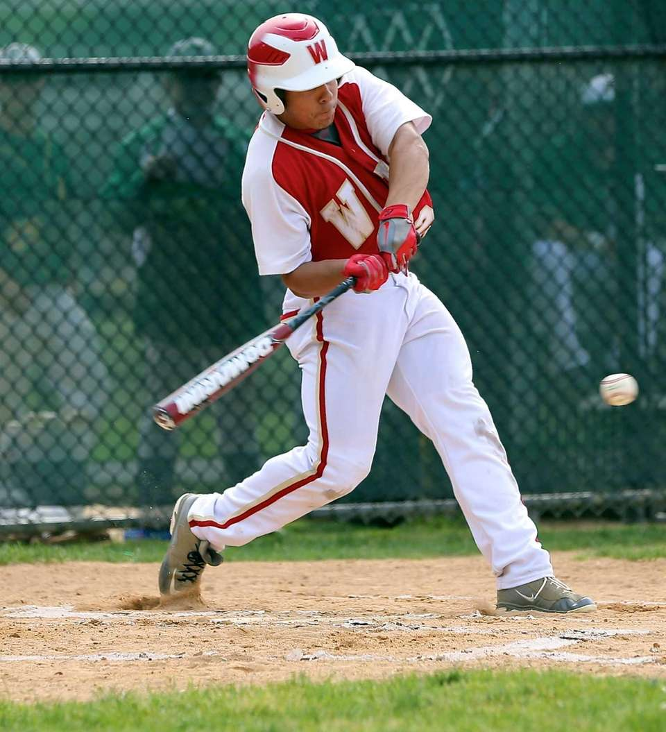 Hills West's Sean Noriega drives a hit to