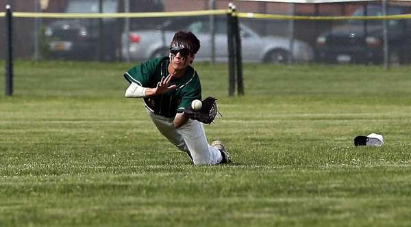 Ward Melville right fielder Chris Peterson makes the