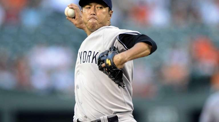 Yankees starting pitcher Hiroki Kuroda delivers a pitch
