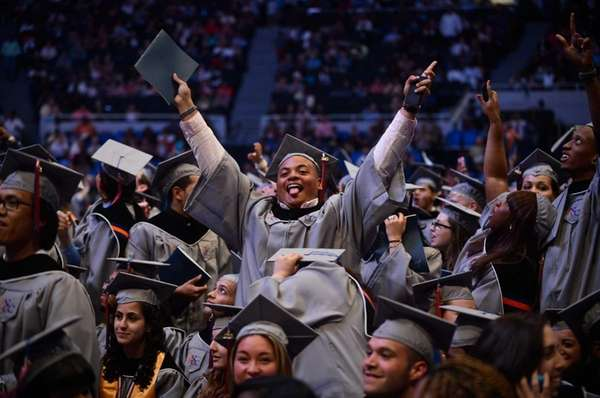 Students celebrate their graduation during the Nassau Community