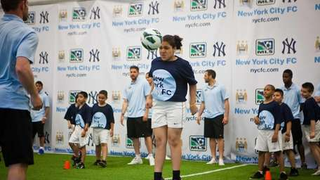 Members of the Manchester City Football Club teach