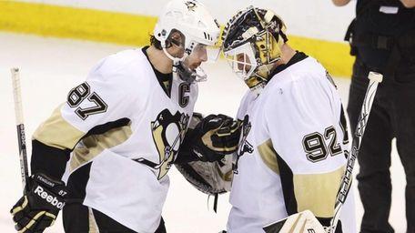 Penguins' Sidney Crosby congratulates goaltender Tomas Vokoun on