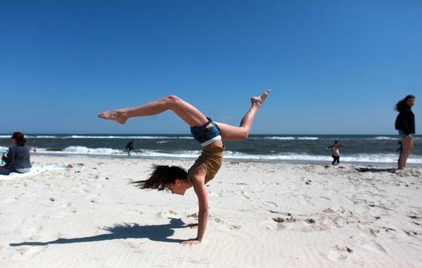 Gia Salinaro, 12, from Massapequa, makes handstands on
