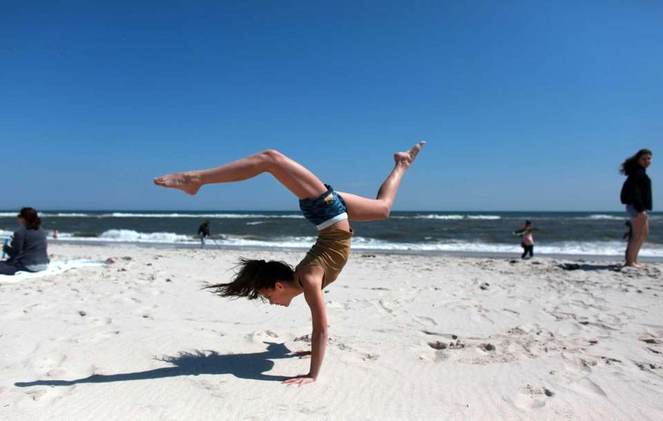 Gia Salinaro, 12, from Massapequa, makes handstands on