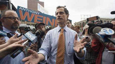 Mayoral candidate Anthony Weiner is swarmed by the