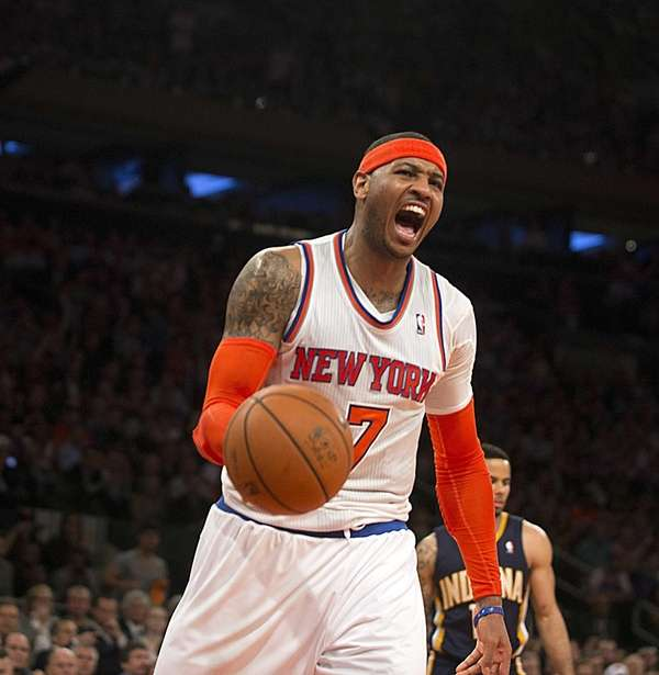 Carmelo Anthony reacts after making a tough basket