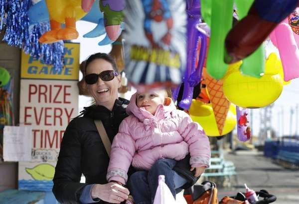 Kim Norrish, of Delran, N.J., holds one-year-old daughter