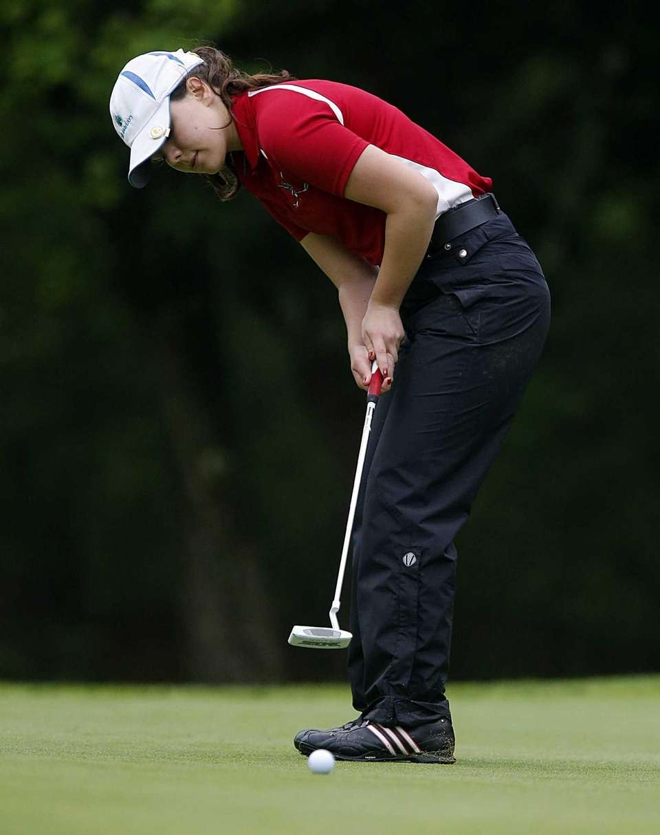 Smithtown East's Cassie Hall with the putt on