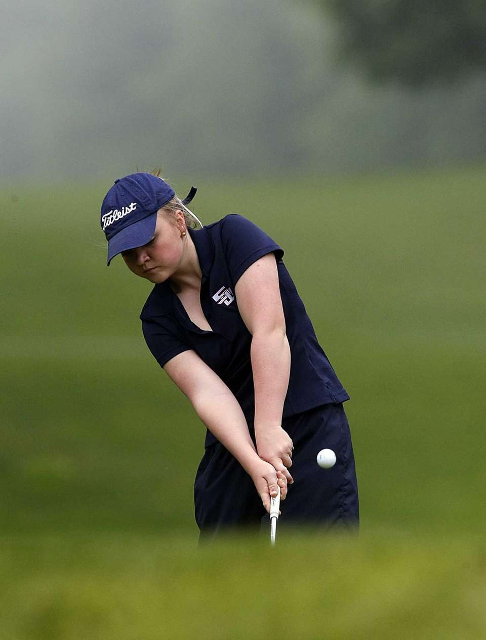 Smithtown West's Emily Doveala chips from the rough