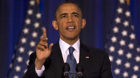 President Barack Obama reacts to a woman yelling