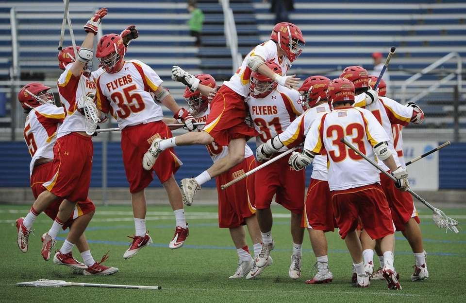 Chaminade teammates celebrate their 7-5 win over St.