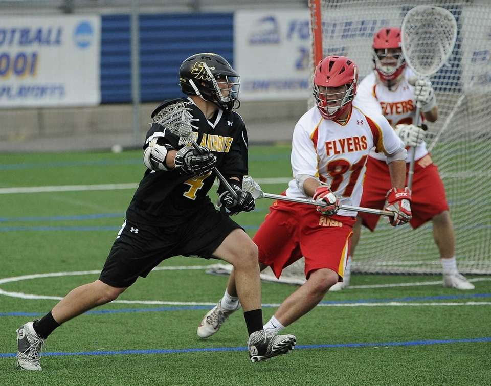 Chaminade defender Brian Dunne guards St. Anthony's Dylan