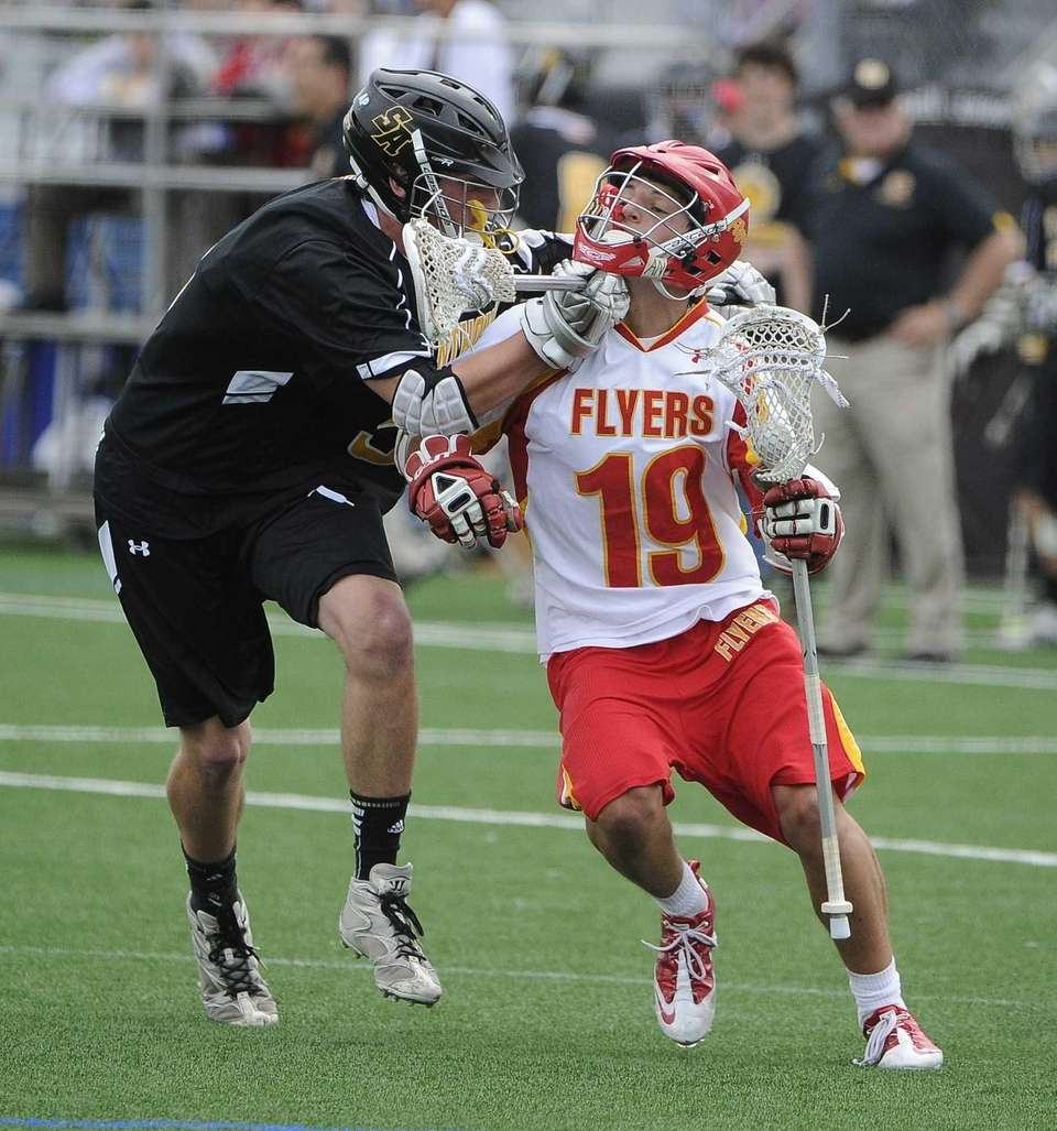 Chaminade attacker Ryan Lukacovic gets checked by St.