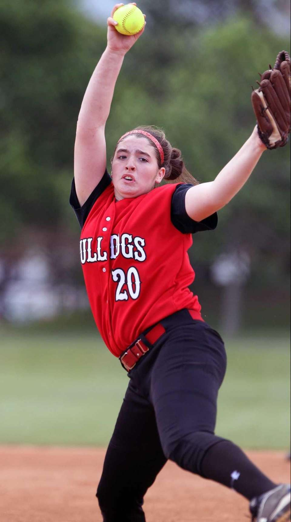 Island Trees Alannah Basile pitches against Plainedge. (May