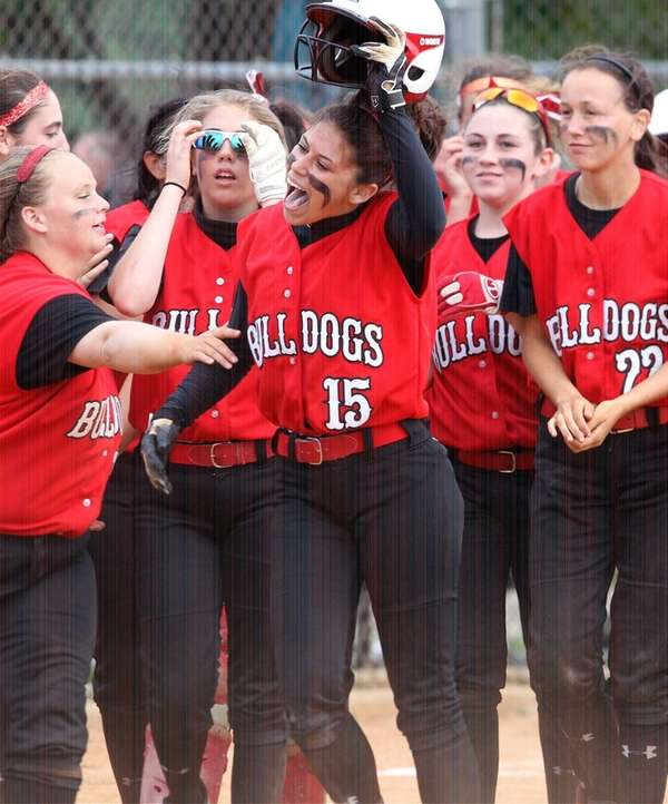 Island Trees' Christie Ciaramitaro celebrates her two-run home