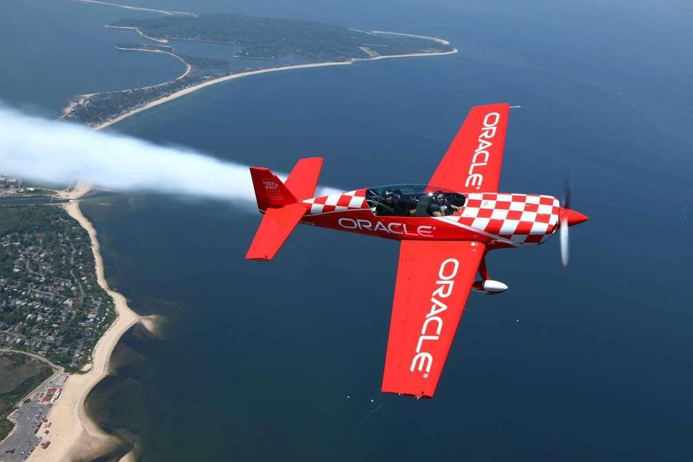 Team Oracle aerobatic pilot, Sean Tucker, left, takes