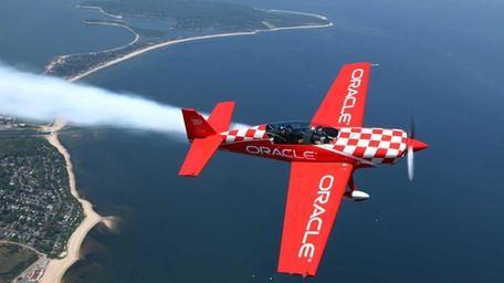 Team Oracle aerobatic pilot, Sean Tucker, left, takes
