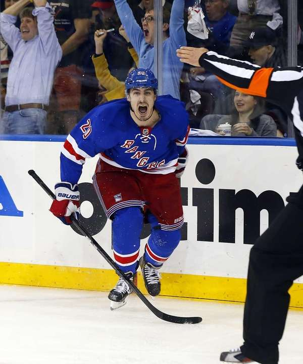 Chris Kreider of the Rangers celebrates his overtime
