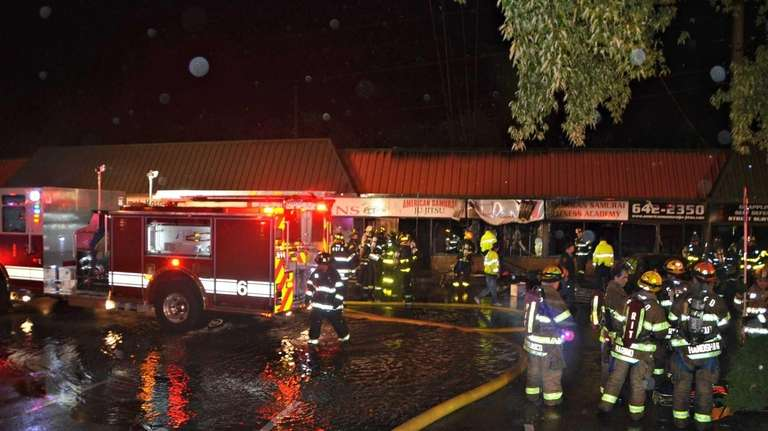 Firefighters on the scene of a late-night fire