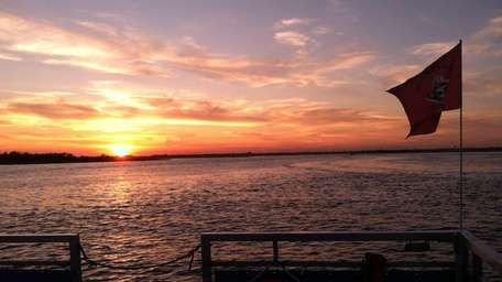 Sunset view from back of Freeport Water Taxi