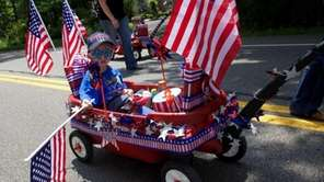 Children --- and wagons -- decked out in
