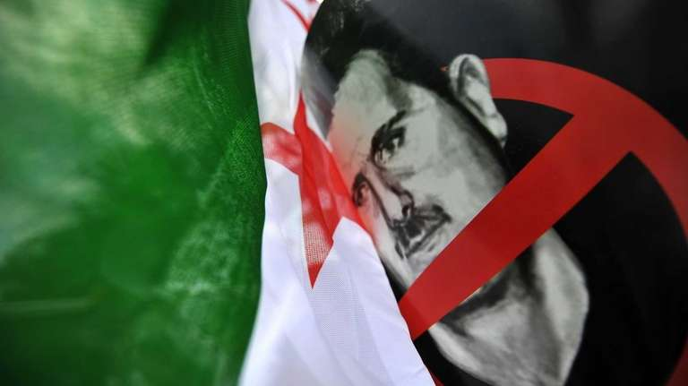 A Free Syria's flag is seen next to