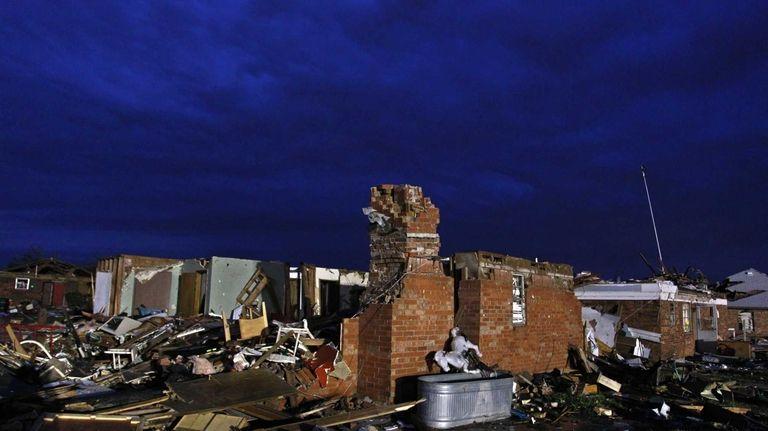 Dawn breaks over the rubble left earlier in
