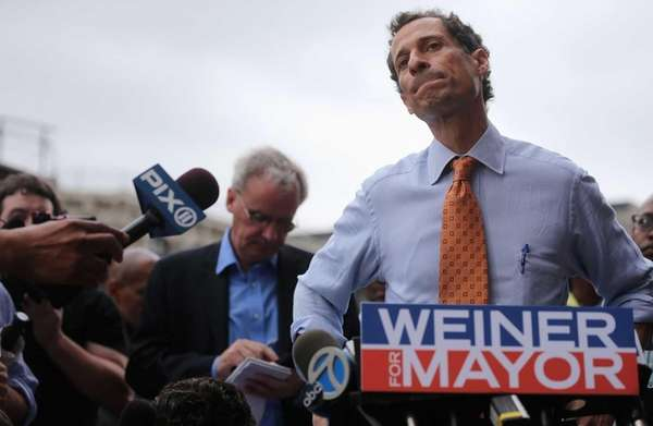 Anthony Weiner listens to a question from the