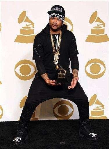 The-Dream poses backstage with the awards for best