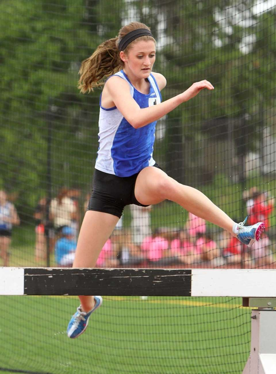 Jessica Scheriff of North Babylon jumps over a