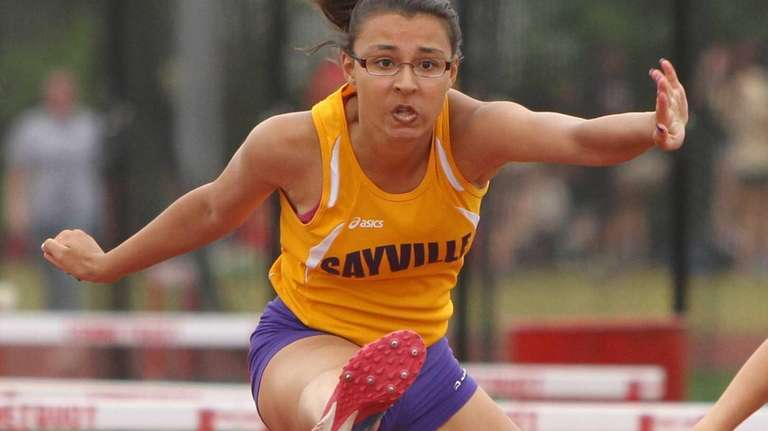 Josephine Colon of Sayville clears a hurdle to