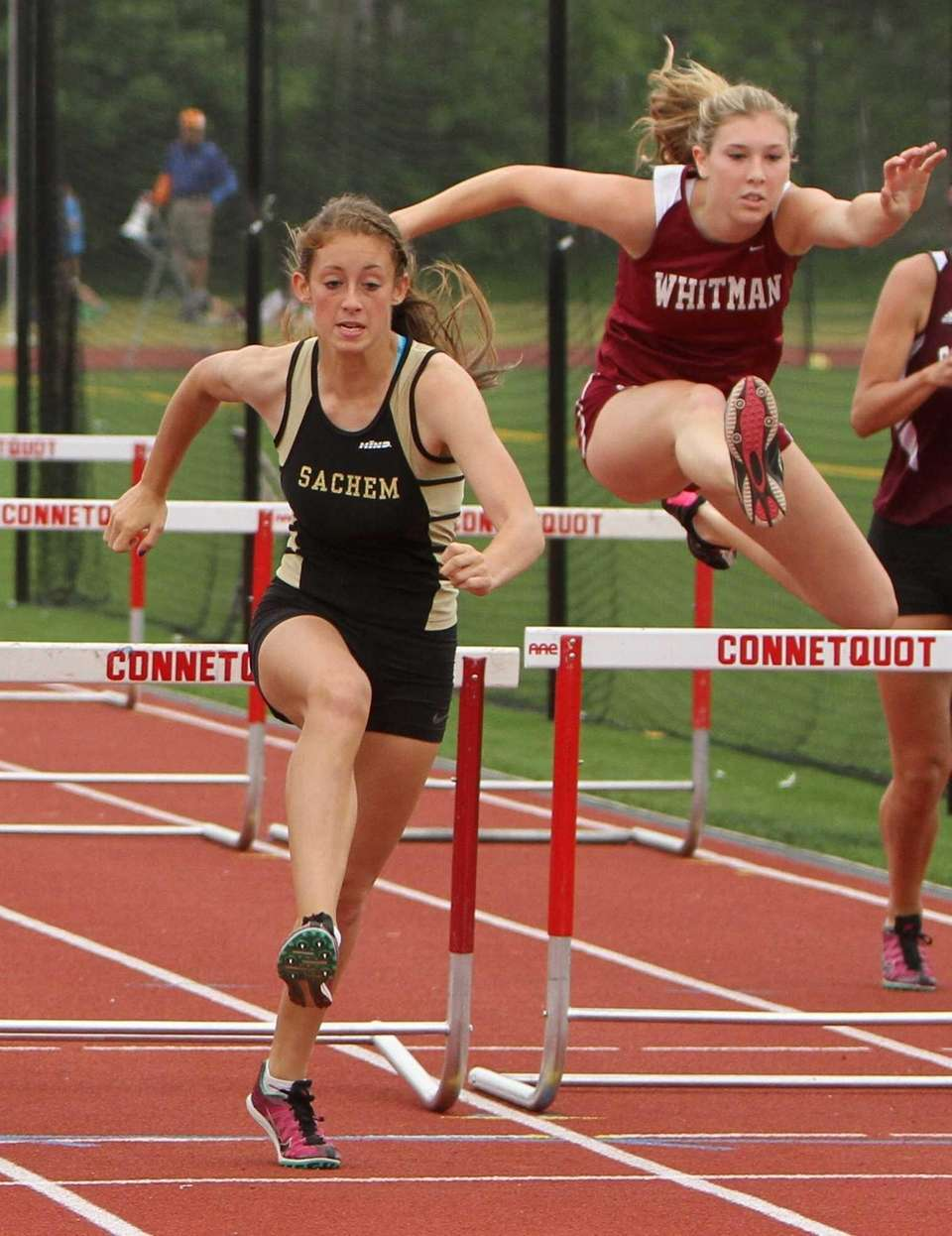 Nikki Fogearty of Sachem North clears the last