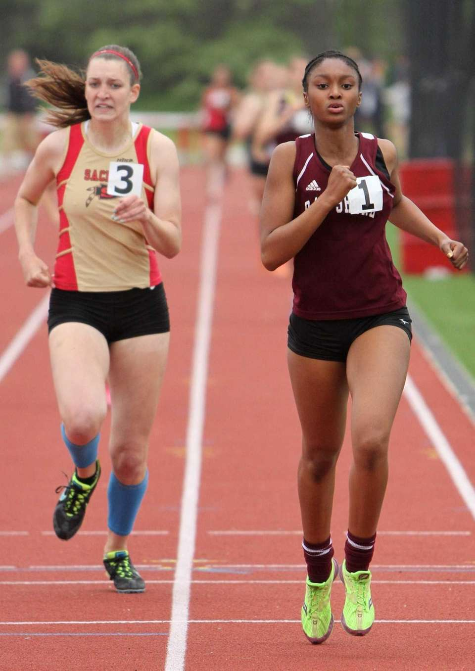 Nailah Braxton of Bay Shore crosses the finish